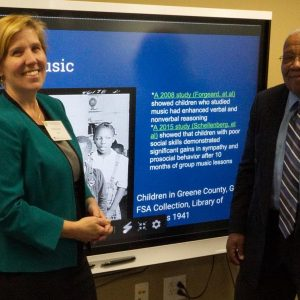 Claudia Stack and Dr. Richard T. Newkirk making presentation